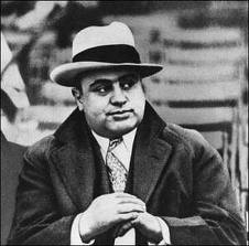 Al Capone leaning on his belly putter.
